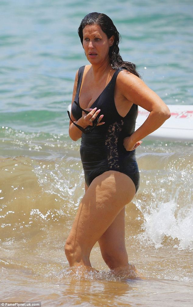 Making a splash: Patti cools down with a refreshing dip in the sea