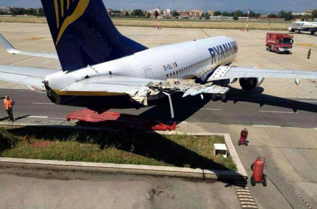 This is the damaged caused to a  Ryanair plane after it rolled 40 metres into a fire station at Rome's Ciampino airport, causing more than £200,000 worth of damage