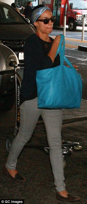 Comfort first! She kept it casual in a long-sleeved top teamed with grey trousers