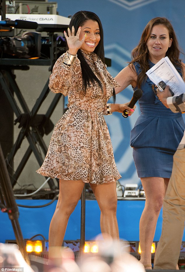 Demure for her: Nicki wore her dark hair loose and straight and sported black eyeliner and glossy nude lips