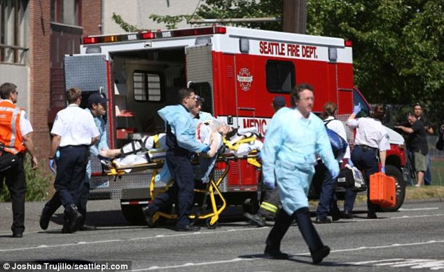 Medics work on one of the victims from the deadly Seattle Pacific University shooting before taking the subject to the hospital for treatment