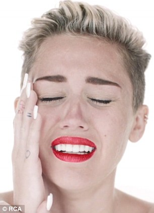 Raw emotion: While her now infamous track Wrecking Ball, pictured, touched on her sadness following her split from her fiance, Miley does not hold back on her secret track, pointing finger at Liam