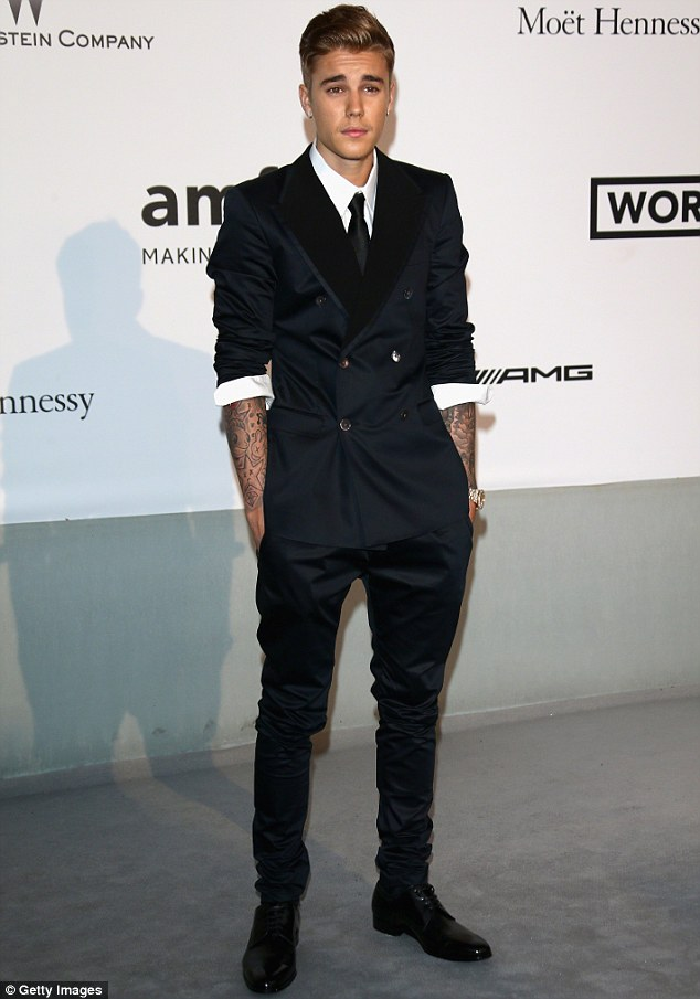 'Very sorry': Justin (pictured in France on May 22) has already apologised for the two videos in which he made racially insensitive remarks and a number of famous people have supported him including 50 Cent