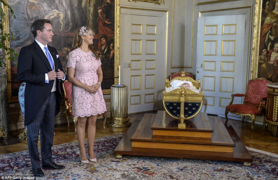 Princess Madeleine of Sweden (R) and her husband Christopher O'Neill watch Princess Leonore rest in Karl XV's crib after the christening ceremony in the Drottningholm Palace church outside Stockholm, Sweden