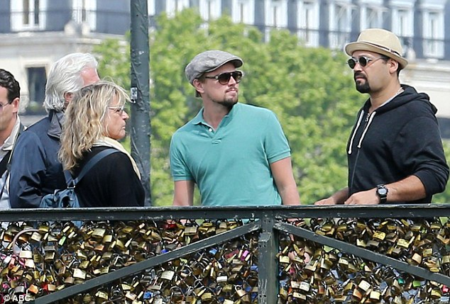 Actor Leonardo DiCaprio visits the iconic Pont des Arts with friends