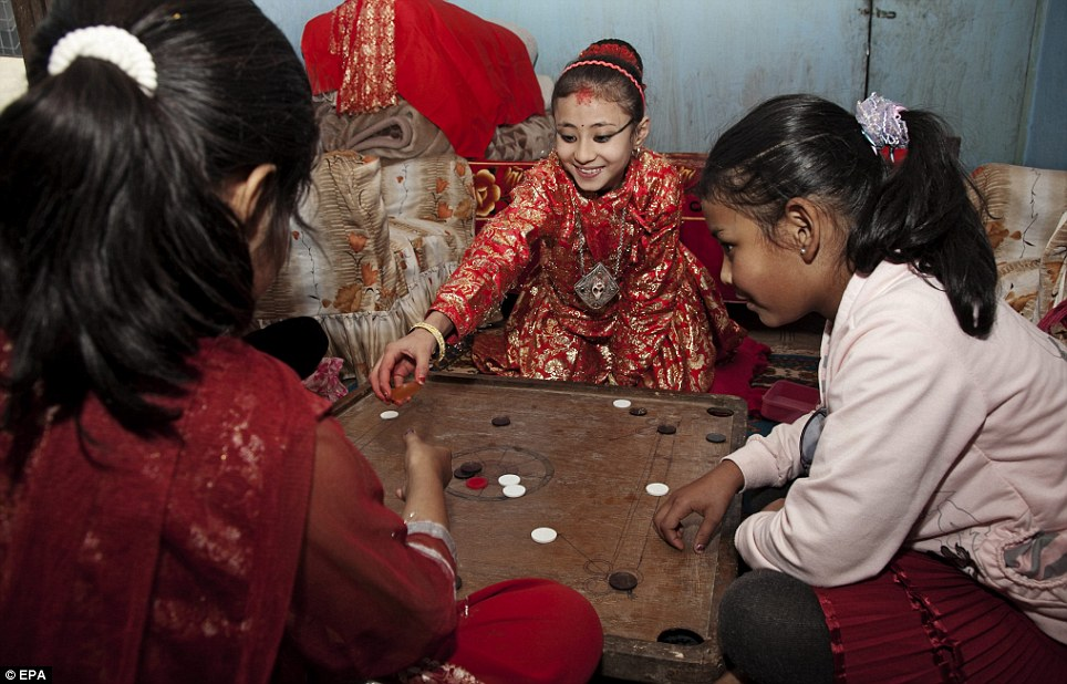 Kumari Samita Bajracharya (C) plays with her friends at Kumari Ghar in Patan City, Nepa