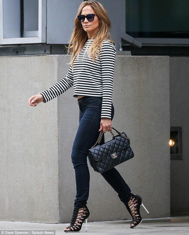 Olhando melhor do que nunca: Jennifer Lopez foi visto deixando um prédio de escritórios NYC na terça-feira como seu representante confirmou ao MailOnline que ela estará se apresentando na Copa do Mundo no Brasil, depois de tudo