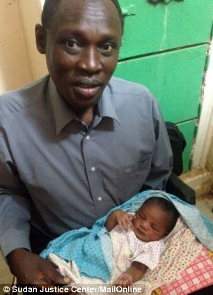 Daniel Wani, Ms Ibrahim's Christian husband, with their daughter: The couple's 20-month-old son was also jailed
