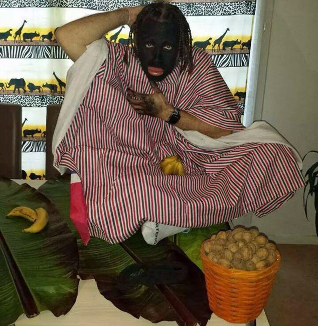 One of the photos shows one officer with a bunch of bananas, scratching himself if he were a monkey, with a bucket of nuts on the ground in front of him