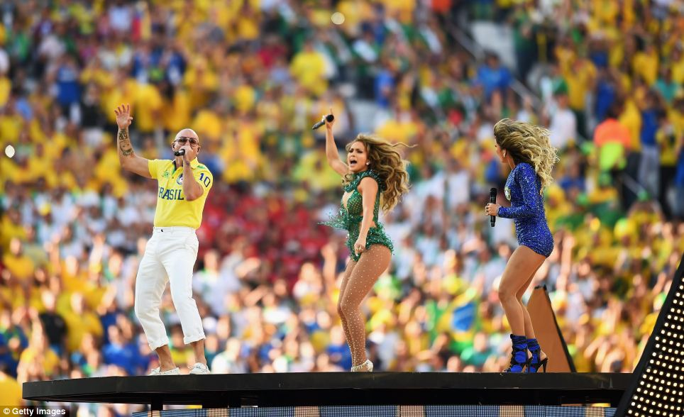 Singer Jennifer Lopez, rapper Pitbull and Brazilian popstar Claudia Leitte bounced around the giant stage as they sang the official World Cup song 'We Are One (Ola Ola)' during the opening ceremony