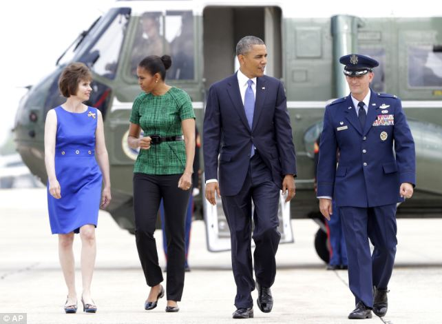 Priorities: Obama left the Iraq situation on the desks of his national security advisers while he took off to North Dakota for an event with Sioux tribal leaders, along with first lady Michelle Obama (2nd L)