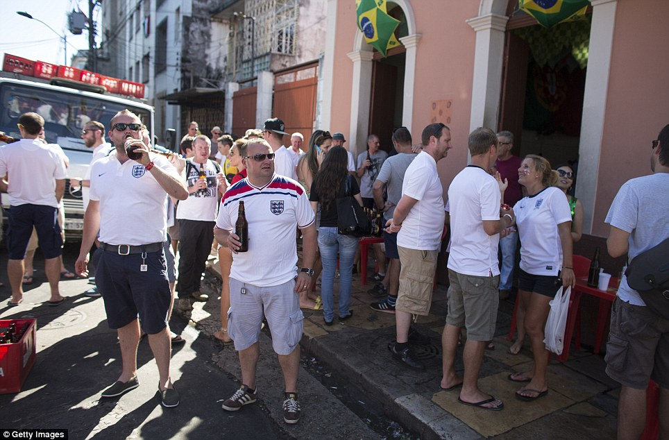 Getting started: England fans warm up for the match in the national fashion at a bar in Manaus. The kick-off is at 6pm local time