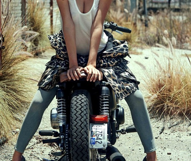 Biker Babe Miranda Kerr Flaunts Her Cleavage As She Rests On A Motorbike In A