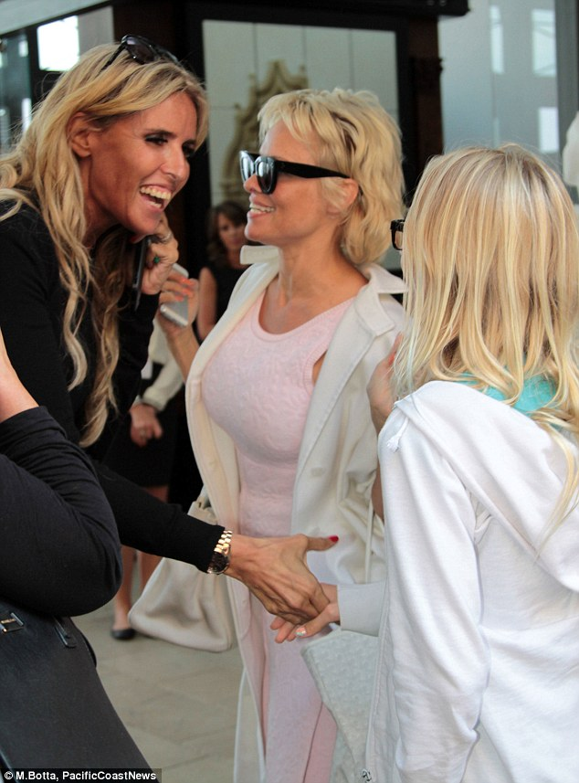 Ciao! The blonde beauty exchanged pleasantries with a friend