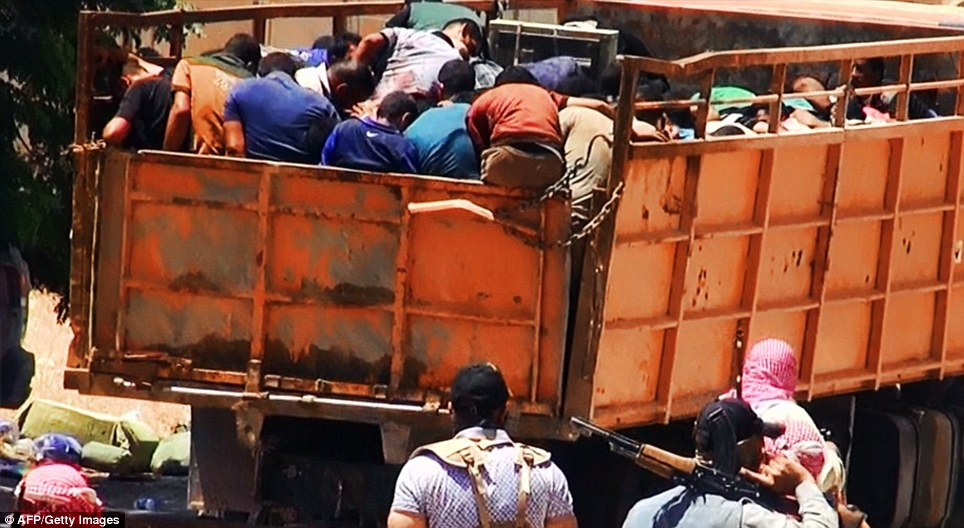 Driven to their deaths: Further images emerged this morning showing crammed truckloads of prisoners allegedly being driven by ISIS soldiers to the site of their execution