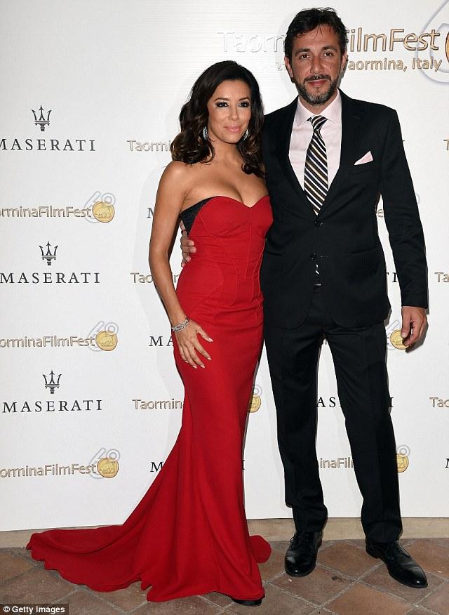Smoking hot: Eva posed alongside Salvatore Iuzzolini from Maserati