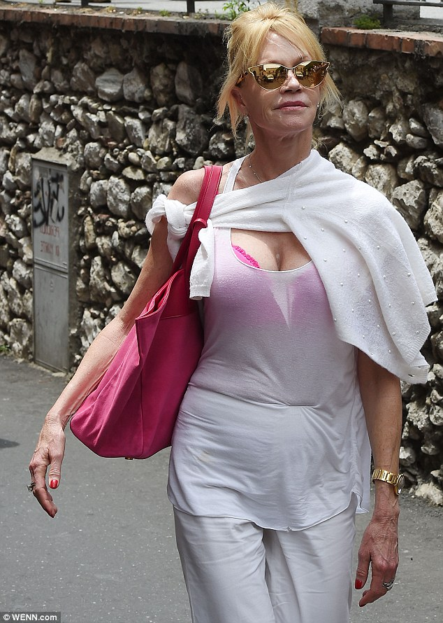 Pretty in pink: Later in the day, Melanie was seen in a white ensemble with a brightly-coloured bra