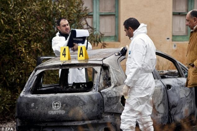 Fear: The discovery of the bodies of three-year-old Nicola Campolongo and his grandfather in a burnt-out Fiat Punto (pictured) sent shockwaves through Italy