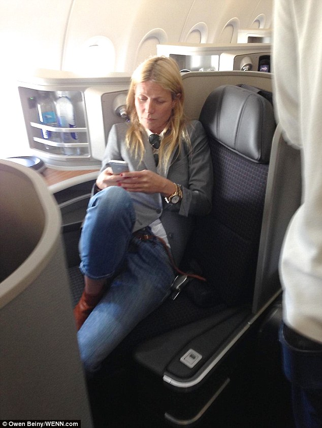 Gwyneth Paltrow Is Busy On Her Phone As She Takes First