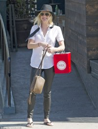 Anna Faris opts for androgynous chic in tight black faux ...
