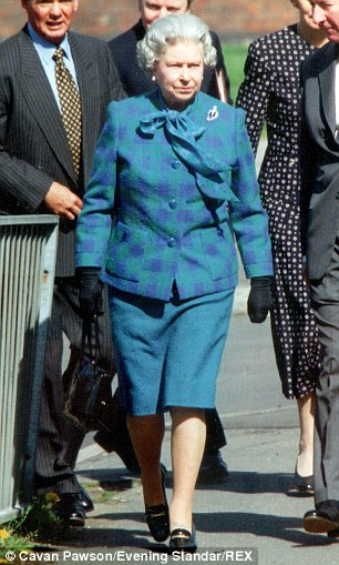 1996: She has long since dispensed with boxy jackets, but the patent leather remains