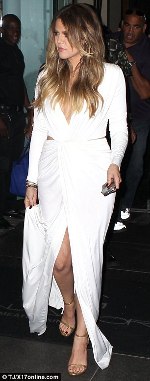 Elegant but sexy: Khloe's dress featured a low-cut neckline, cut-out sides and a split up the front