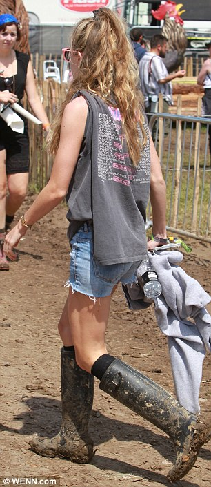 Not worried: Cressida showed just how down to earth she is wearing muddy wellies as she strolled around