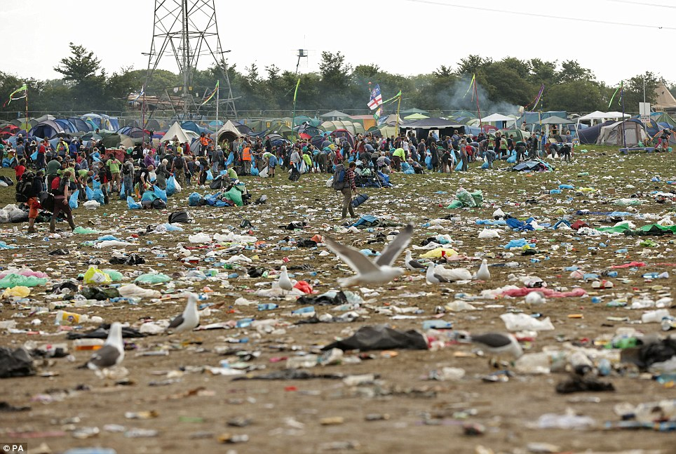 Rubbish: The litter strewn around the Pyramid Stage area as the clean up operation begins on site, at the Glastonbury Festival, at Worthy Farm