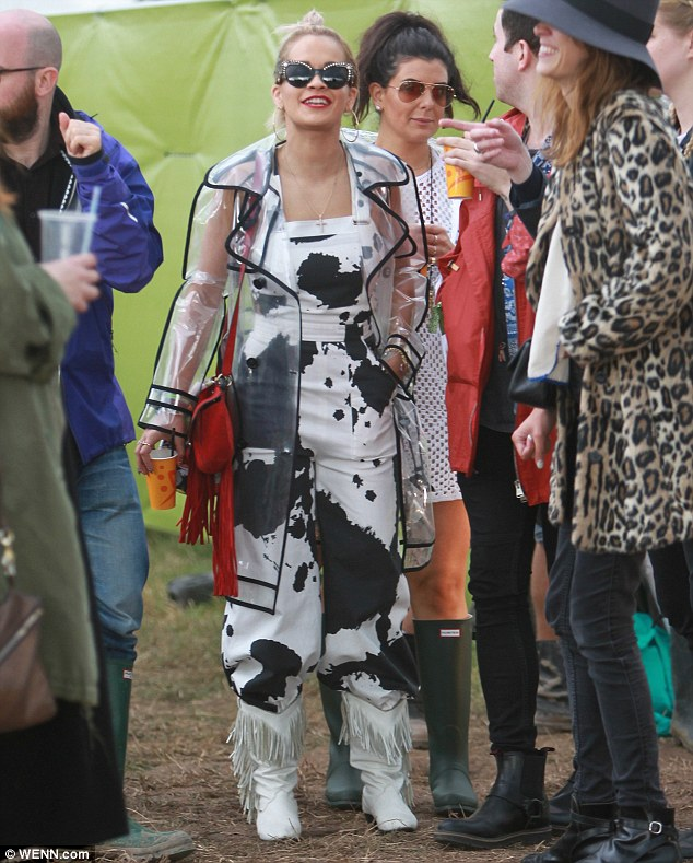 She must be Friesian! Rita wore a questionable black asnd white print ensemble at a wet and muddy Worthy Farm in Somerset on Saturday