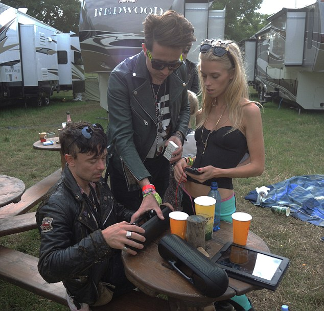 Party boy: Nick Grimshaw set up his Beat Pill XL speakers to play some tunes for Robbie Furze and Lady Mary Charteris