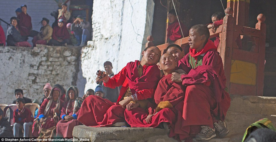Captivated: Young monks enjoying themselves at the annual Torgya Festival in Tawang