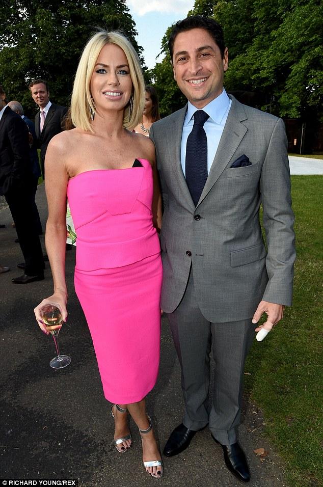 Handsome couple: Caroline posed with her husband, financier Cem Habib at the event