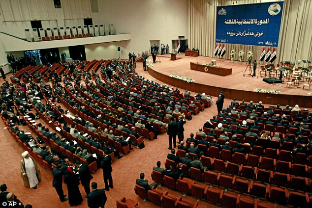 Iraq's newly elected members of parliament attend their first government session in the heavily fortified Green Zone in Baghdad this morning
