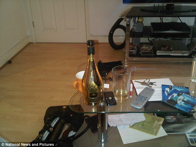 National News and Pictures   A fraudster nicknamed 'Fizzy' for his love of champagne was today jailed for eight years for conning nearly £2 million out of vulnerable pensioners in a lottery scam to fund his luxury lifestyle, bubbly and fast cars.    Frank Onyeachonam, 38, deliberately preyed on the elderly in a lottery scam robbing some of them of their lifesavings. Detectives identified at least 14 victims but believe there may be another 61 and the total lost could be close to £30 million.   Onyeachonam then spent the cash on Gucci, Louis Vuitton and Armani designer clothes, Rolex watches,  Porches and Maseratis and rented a luxury flat overlooking the Thames in London's Canary Wharf.   A regular in members' clubs Onyeachonam would only drink his favourite Ace of Spades champagne costing between £300 and £500 a bottle.   Such was his love of the fizzy stuff he also kept a fridge stocked full of it at his apartment and had so much cash he once spelled his name out in it and upl