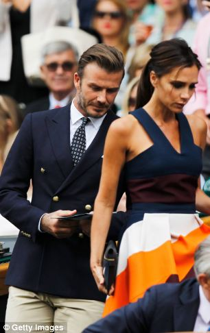 Famous guests: David Beckham and Victoria Beckham take their seats in the Royal Box on Centre Court before the Men's Singles Final match