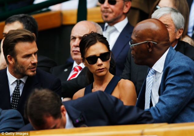 Celebrity chat: David seems engrossed in conversation with actor Samuel L. Jackson, whilst wife Victoria sits in the middle