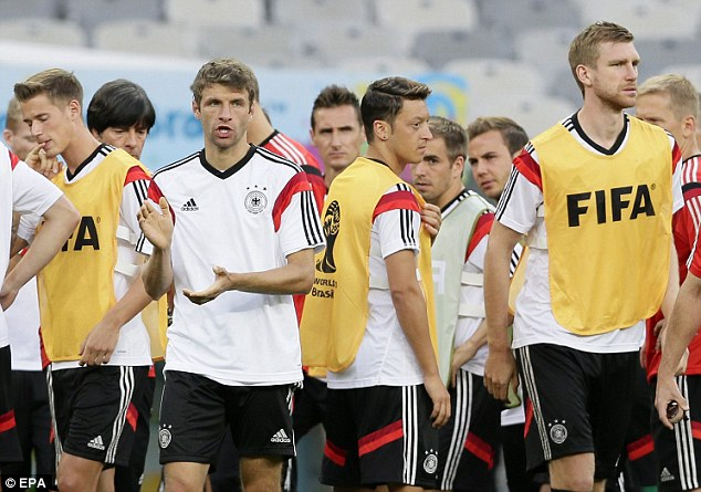 Applaud: Muller (second left) claps his team-mates during their training session ahead of Brazil clash
