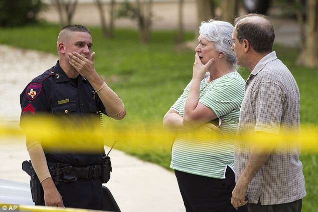 Shocked: Neighbors watched in disbelief as the home where six people were killed was investigated