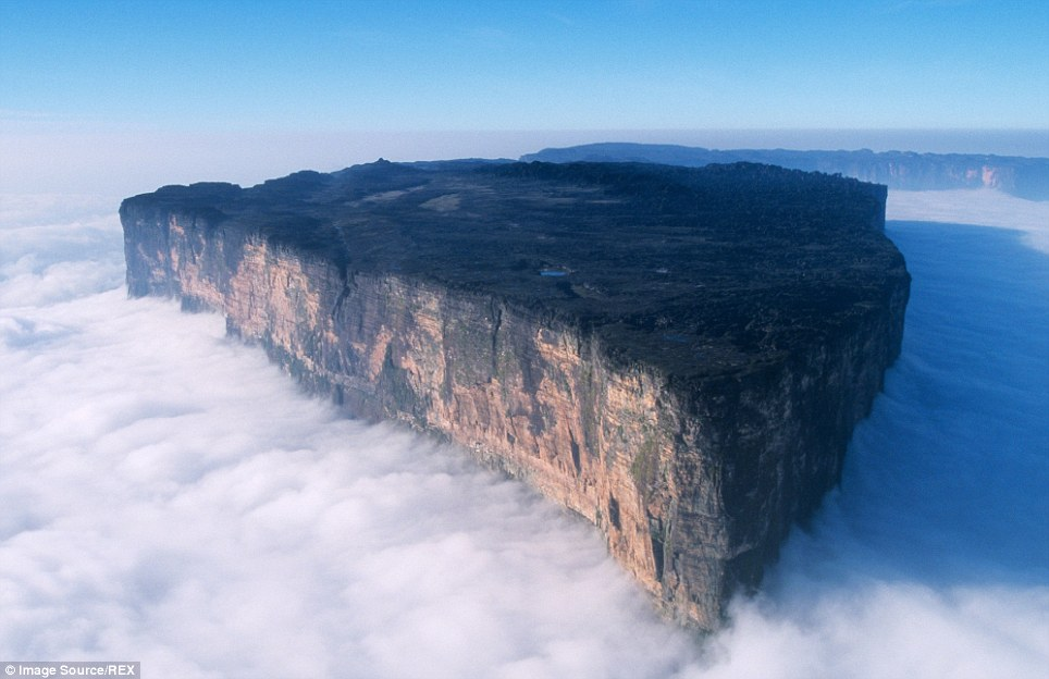 The breathtaking Mount Roraima, the highest of the Pakaraima chain of tepui plateau in South America, peaks above the clouds. Its 31sqkm summit area consists on all sides of cliffs rising 400 metres