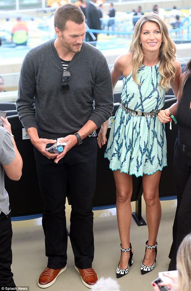 Side by side: Gisele Bundchen arrives at the Maracana with husband Tom Brady