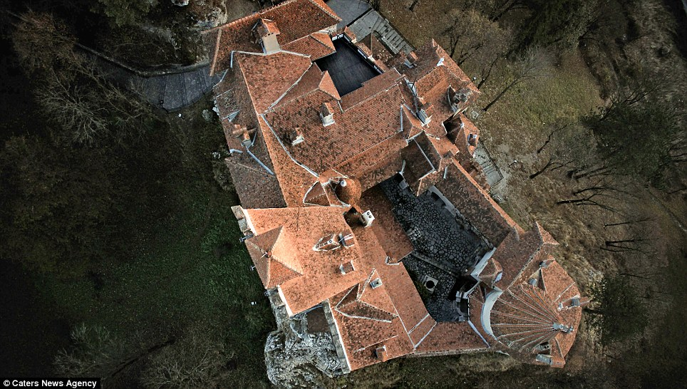View from above: The huge castle dominates the surrounding landscape in the beautiful Romanian landscape