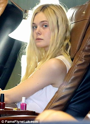 Elle Fanning goes makeup free as she slips into a cute