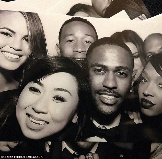 Big names: Chrissy and her husband John Legend, upper middle, took this picture if the photobooth at Kim and Kanye West's wedding in May