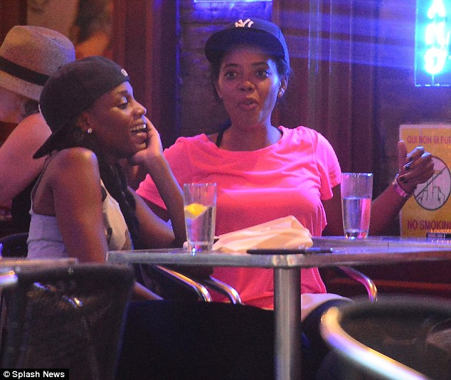 Twinsies: The former 106 & Park host and her assistant Johanna Desrosiers donned matching blue New York Yankee caps as they sat at their table