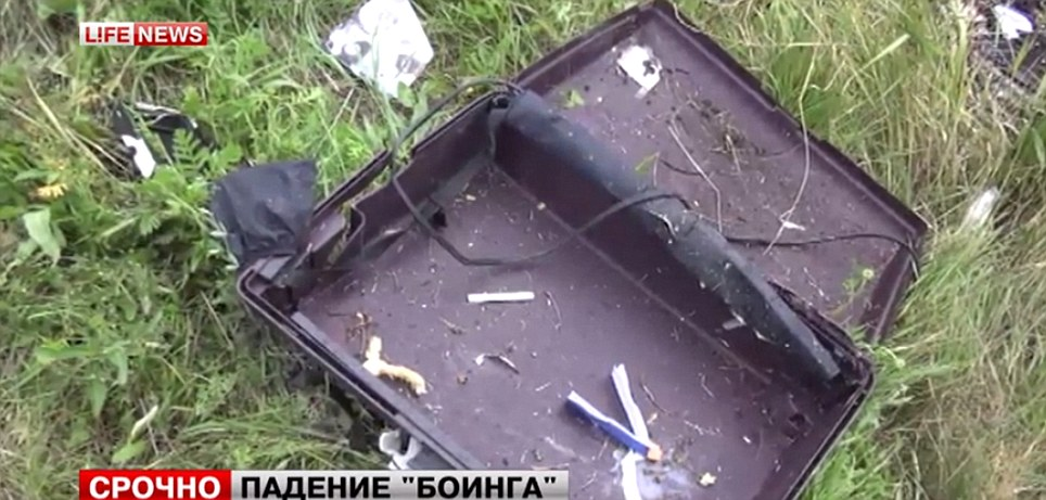 Personal belongings: It is believed the plane was struck by BUK surface-to-air missile at 33,000ft around 20 miles before entering Russian airspace