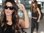 Way to make an entrance! Kate Beckinsale flashes her impossibly taut tummy as she arrives at London Heathrow Airport
