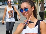 Peace, baby! Jesse Metcalfe's girlfriend Cara Santana rocks a Jimi Hendrix tank as she exits a gym in LA