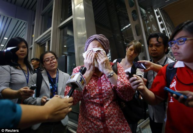 A woman who believes that a relative was travelling on Malaysian Airlines flight MH17 cries as she waits for more information about the crashed plane at Kuala Lumpur International Airport