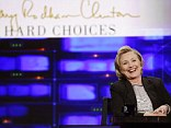 Hillary Clinton, pictured here on The Daily Show with Jon Stewart on Tuesday, put promoting her book ahead of speaking to progressive activists at a gathering this week in Detroit