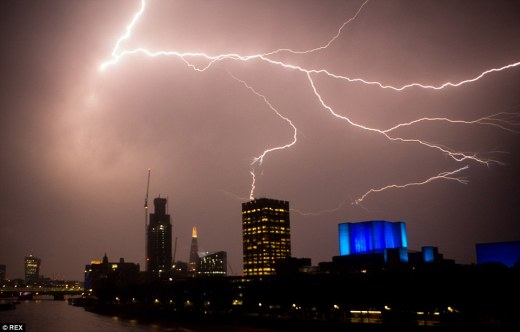 Lightning in the skies as an electric storm passes over London. The UK saw its hottest day of the year yesterday with temperatures set to increase today